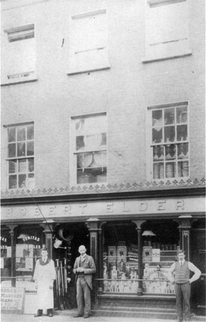 Robert Elder outside his store at 21 Duke Street in 1906.